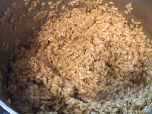 Risotto rice absorbing stock